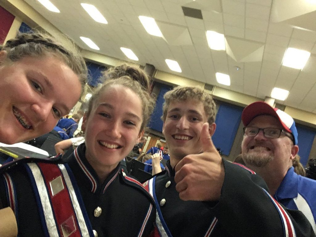 Band students giving thumbs up
