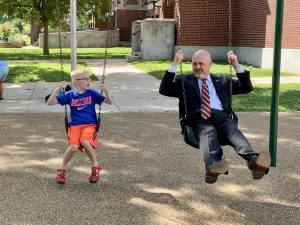 Superintendent Lane and son swinging