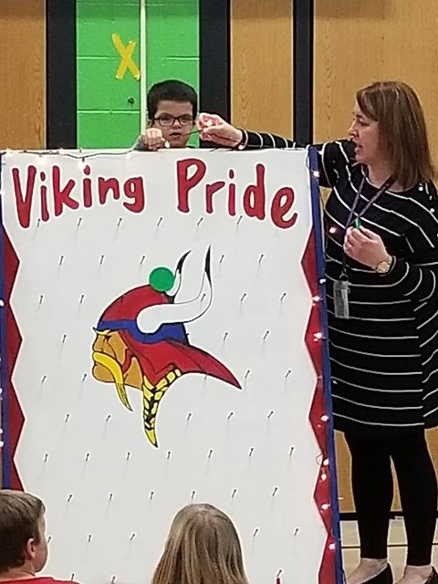 Student with Viking Pride board