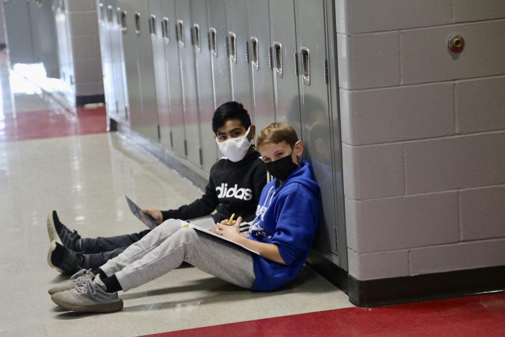 Students sitting in hallway