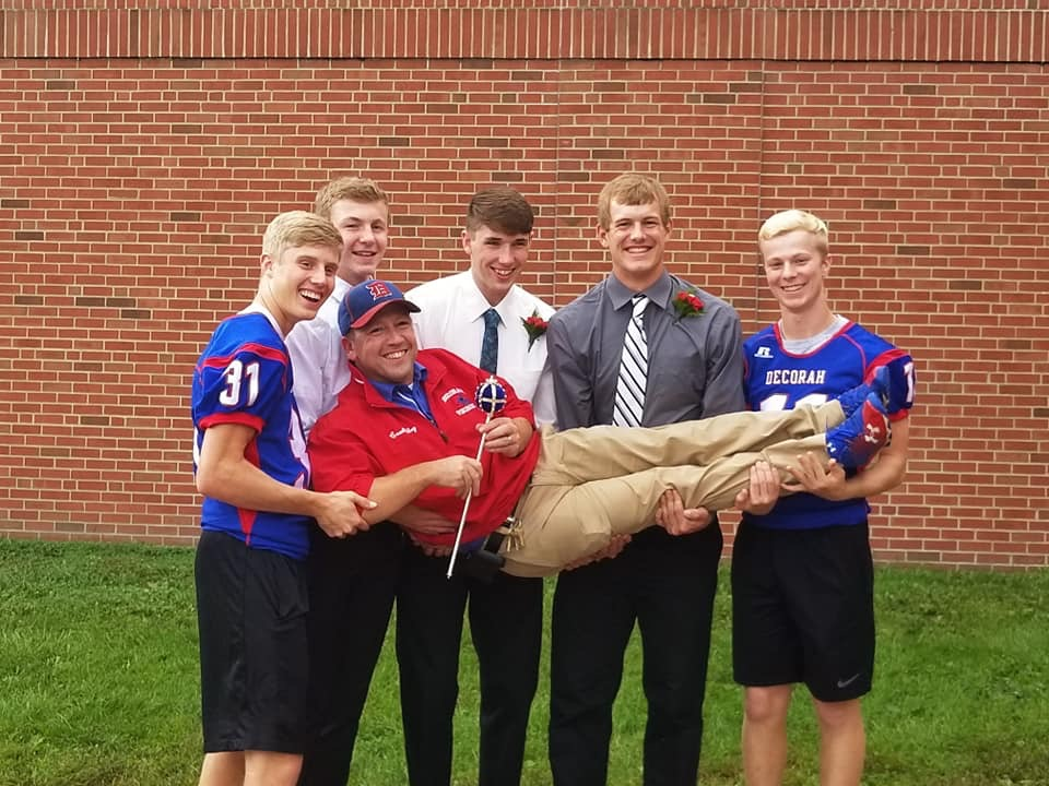 Mr. Riley gets a lift from senior boys