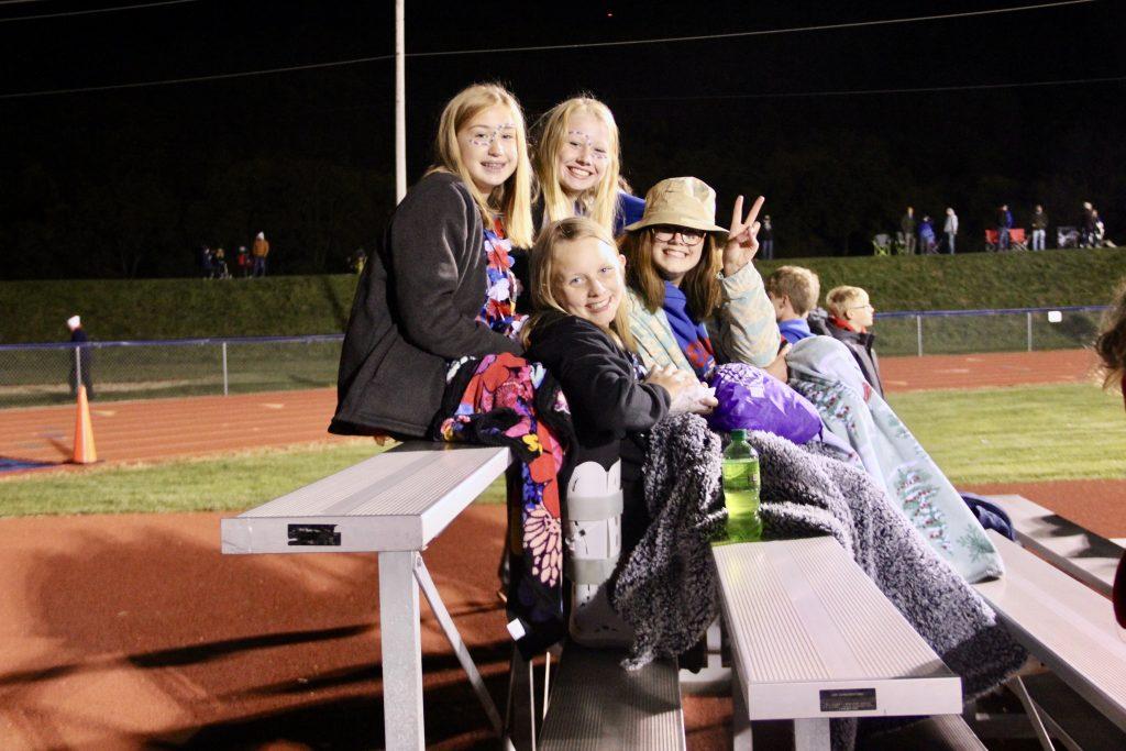 Students on football bleachers