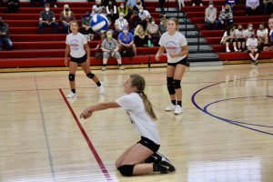 Student bumping the volleyball