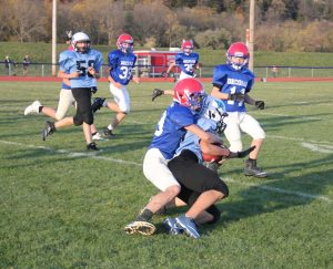 Student tackling an opponent