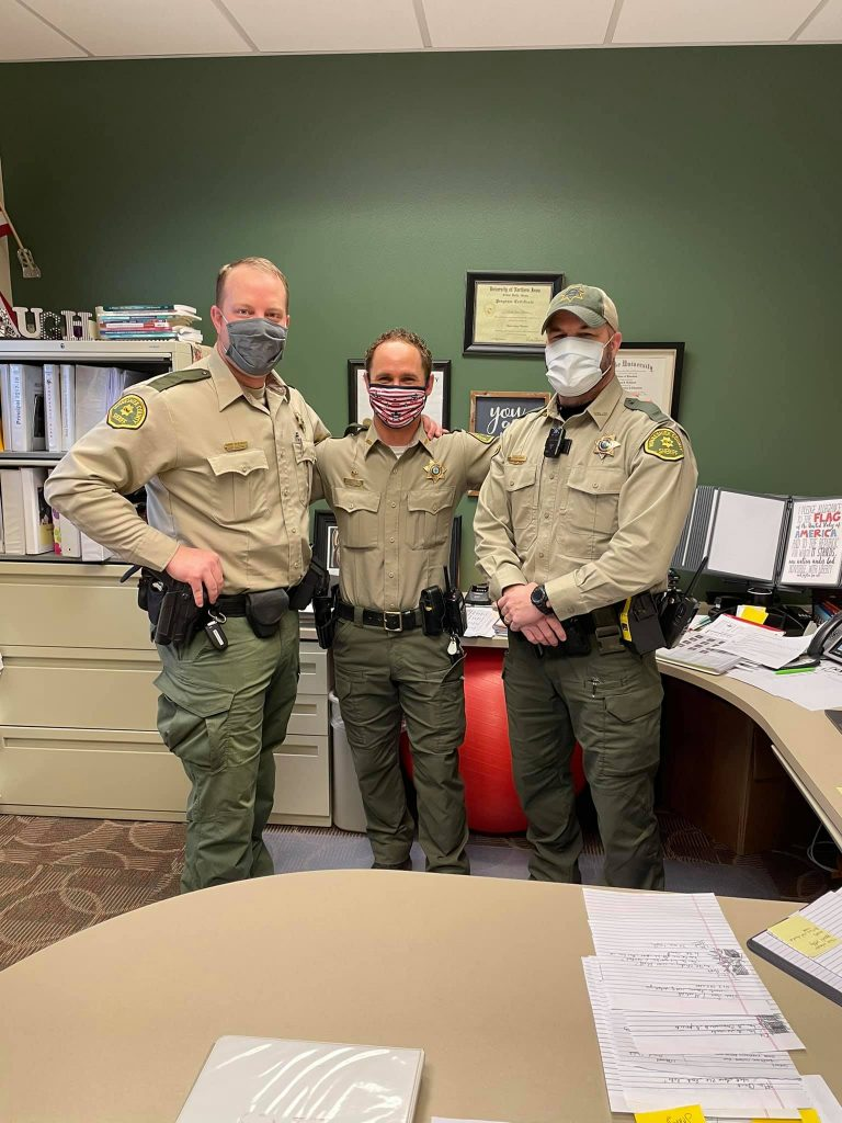 Officers from the Winneshiek County Sheriff's Department serve as guest announcers