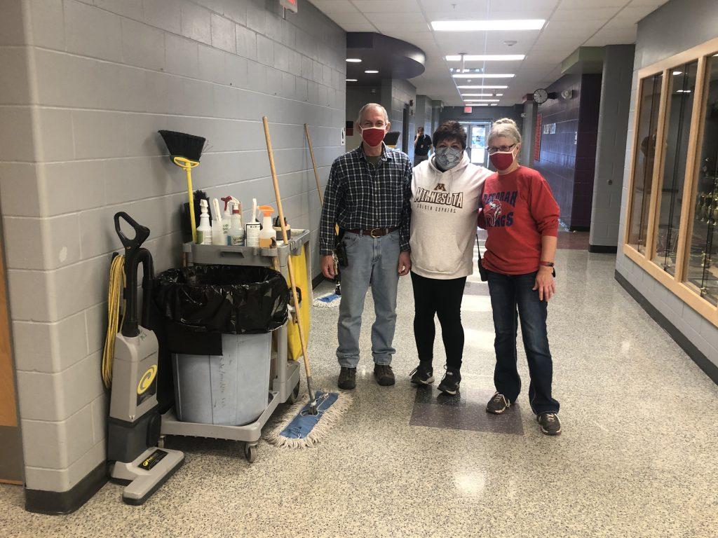 Middle school staff members in hallway