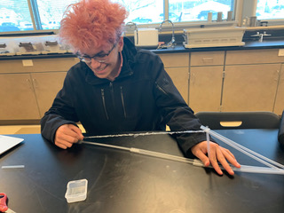 student works on physics olympics event