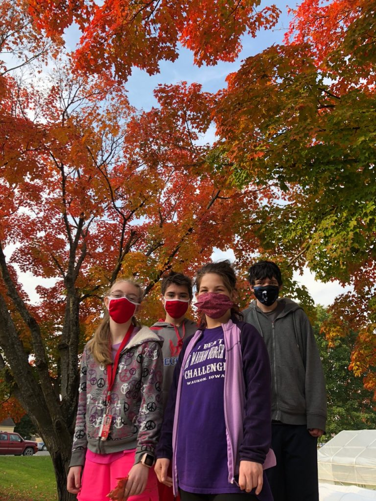 Students with fall trees in background