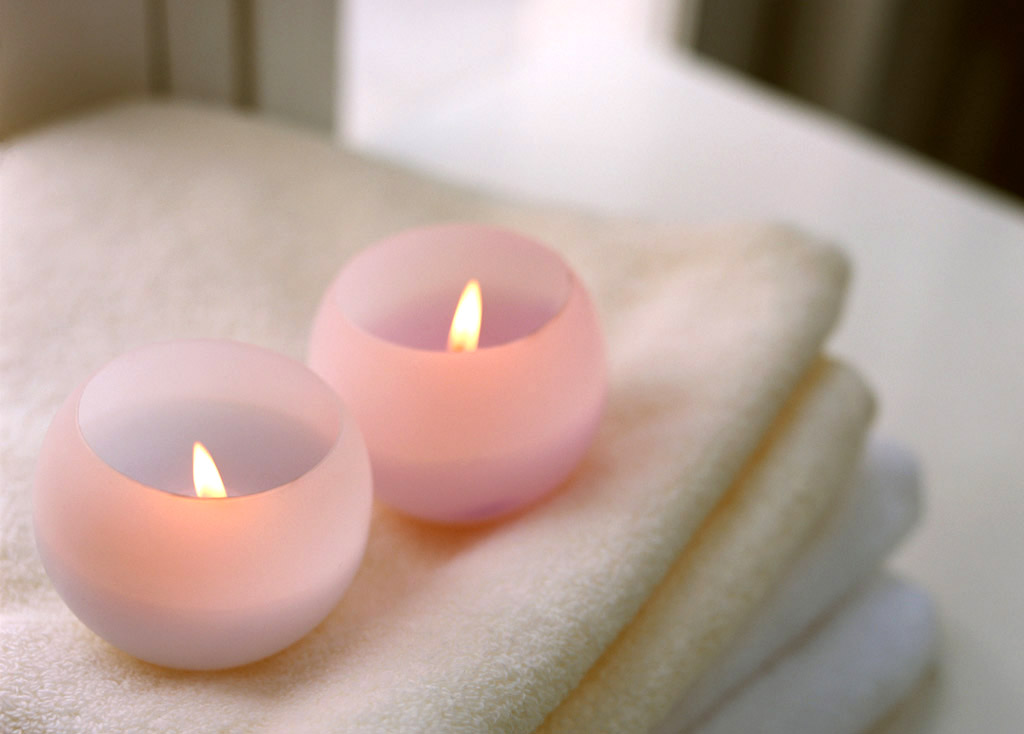 Two candles on towel