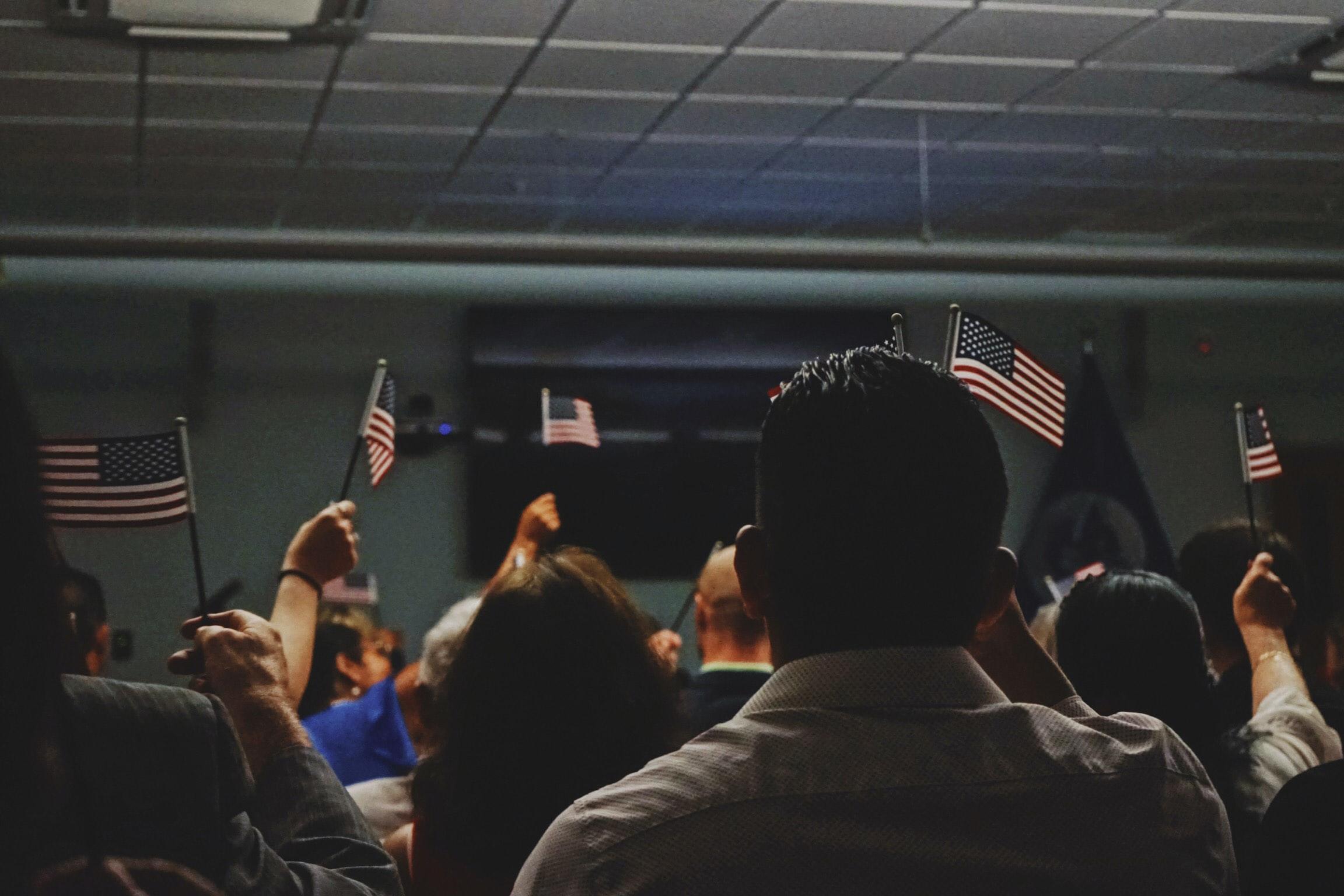 Immigrants waving USA flag