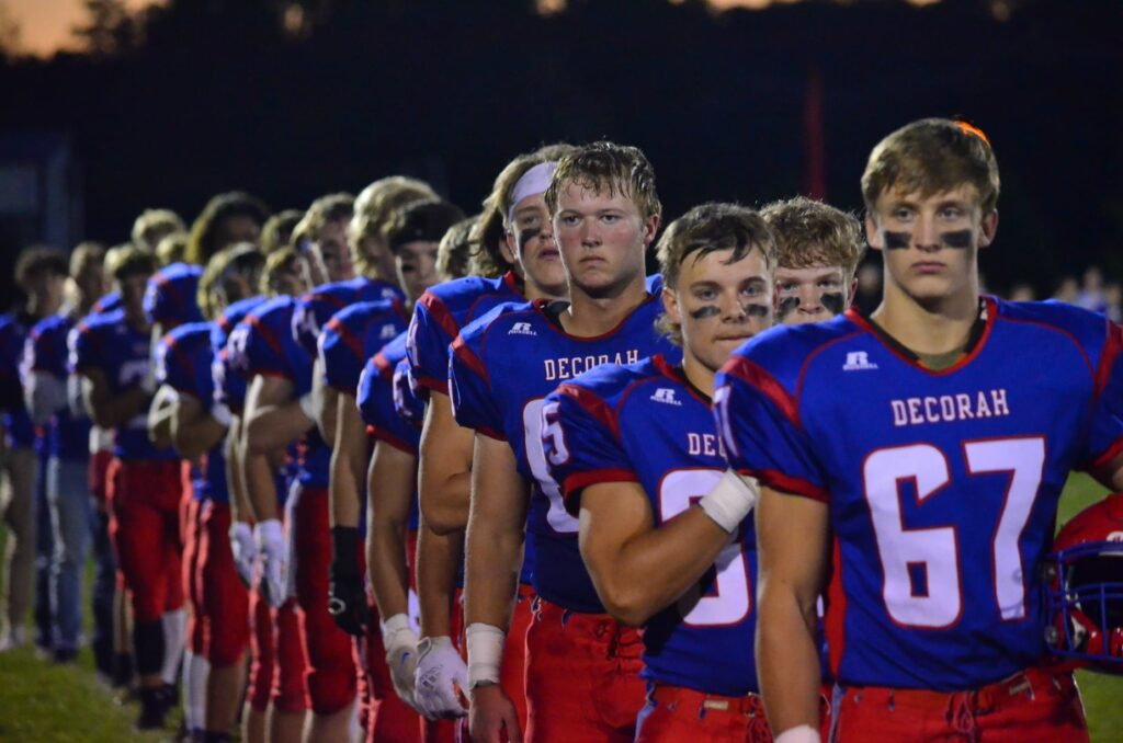 Football players lined up for the National Anthem