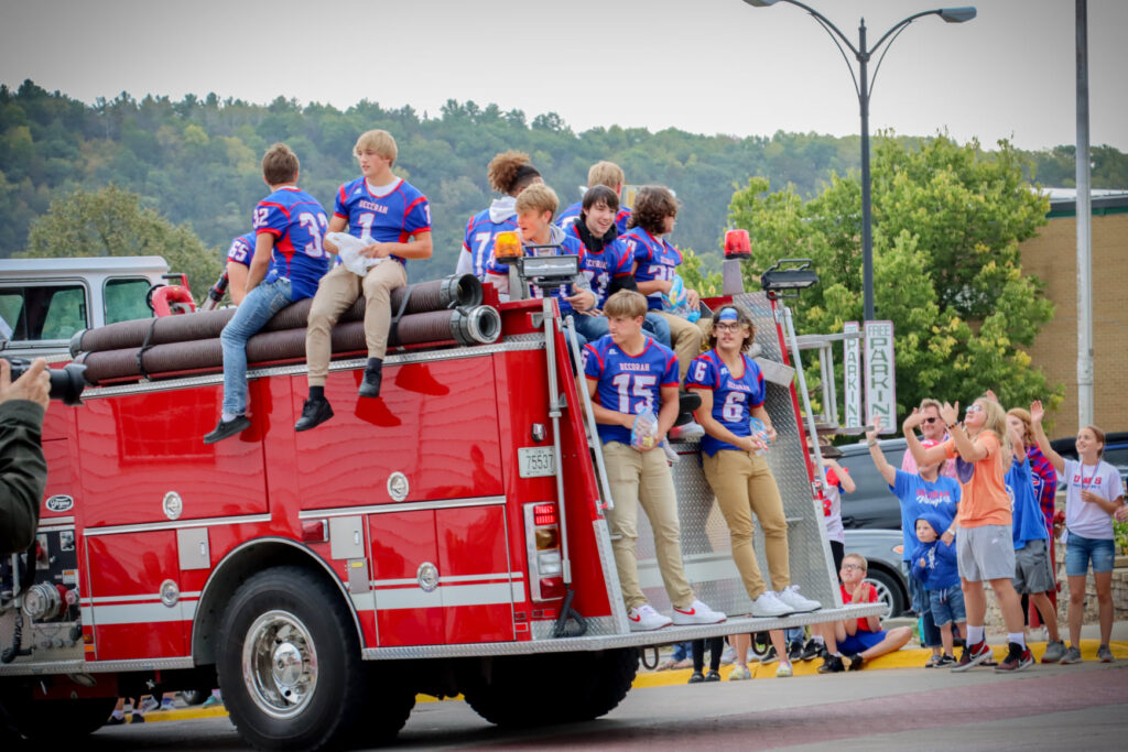 Football players on the Fire truck
