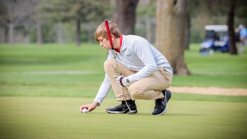 Golfer getting his ball ready