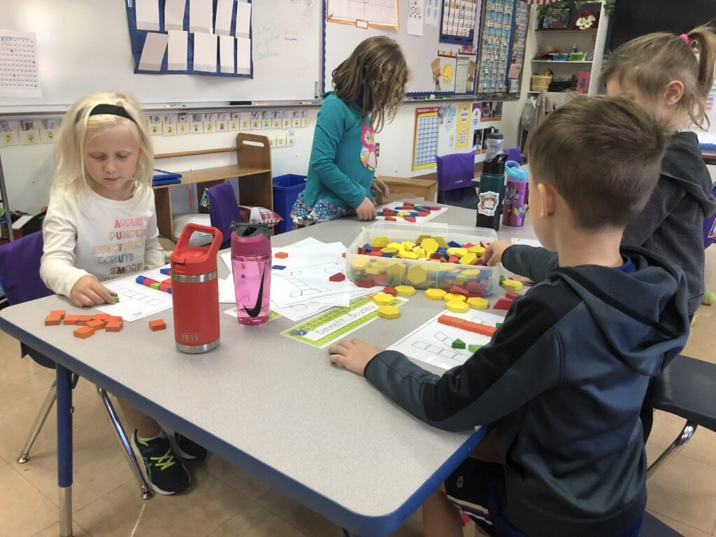 Students using shapes