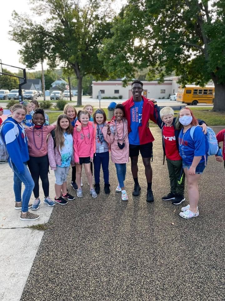 Students with the homecoming king
