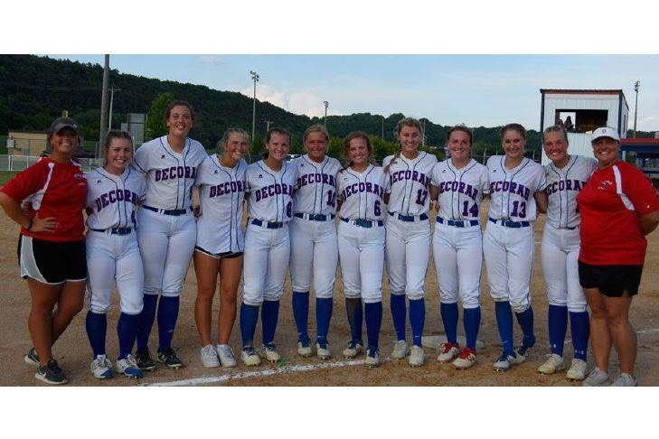 Softball players and coaches
